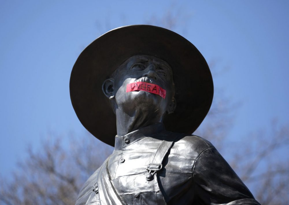"""Tape with the word """"UNHEARD"""" covers the mouth of the sculpture """"The Sower"""" at the University of Oklahoma on March 11, 2015 in Norman, Oklahoma. The statue was marked by the black student group OU UNHEARD at the university. (Brett Deering/Getty Images)"""