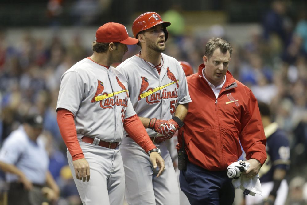 Adam Wainwright (center) sustained a season-ending Achilles injury during an at-bat against the Milwaukee Brewers. (Mike McGinnis/Getty Images)