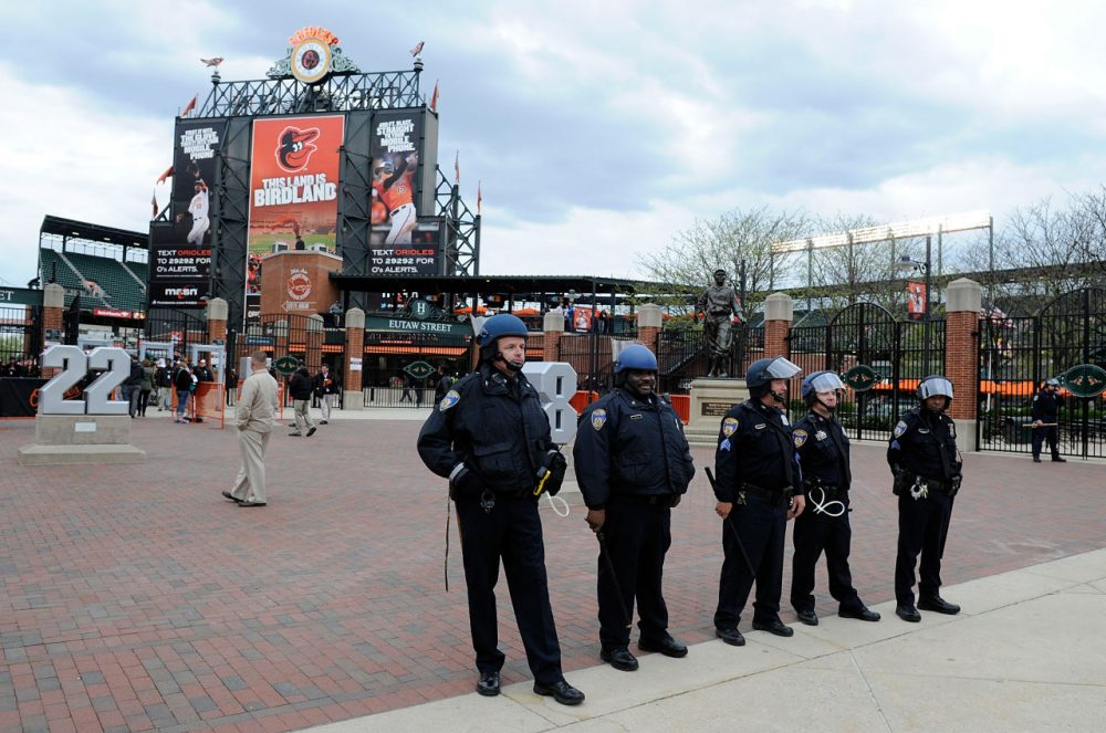 Police stand watch outside Oriole Park at Camden Yards before the game was postponed between the Baltimore Orioles and the Chicago White Sox on April 27, 2015 in Baltimore, Maryland. The move comes amid violent clashes between police and youths, according to news reports, the aftermath of the death of Freddie Gray on April 19 after suffering a fatal spinal injury while in police custody.  (Photo by Greg Fiume/Getty Images)