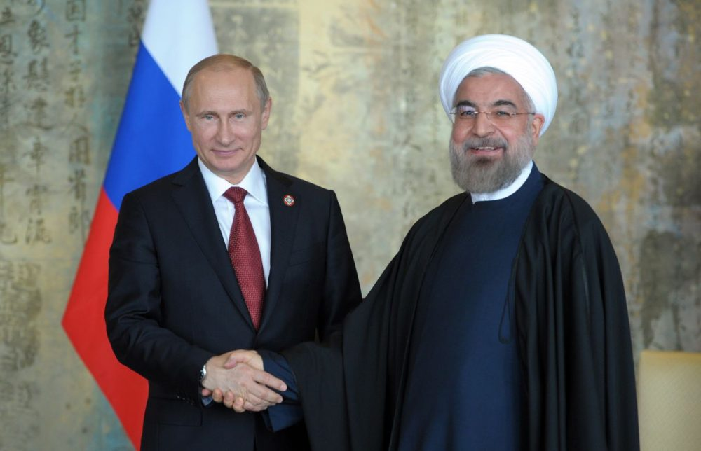 Russia's President Vladimir Putin (L) shakes with his Iran's counterpart Hassan Rouhani during their bilateral meeting on the sidelines of the fourth Conference on Interaction and Confidence Building Measures in Asia (CICA) summit in Shanghai on May 21, 2014. (Alexey Druzhini/AFP/Getty Images)