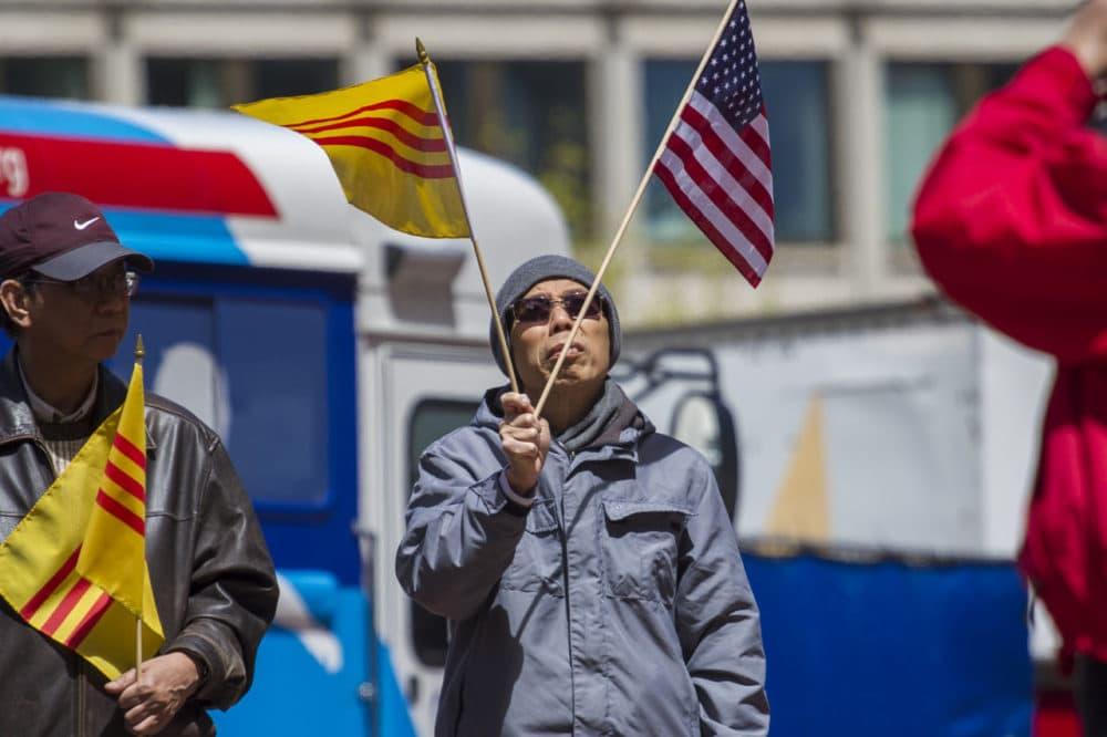 The Vietnam freedom flag raising ceremony at City Hall Plaza marking the 40th anniversary of the fall of Saigon April 30, 2015.  (Jesse Costa/WBUR)