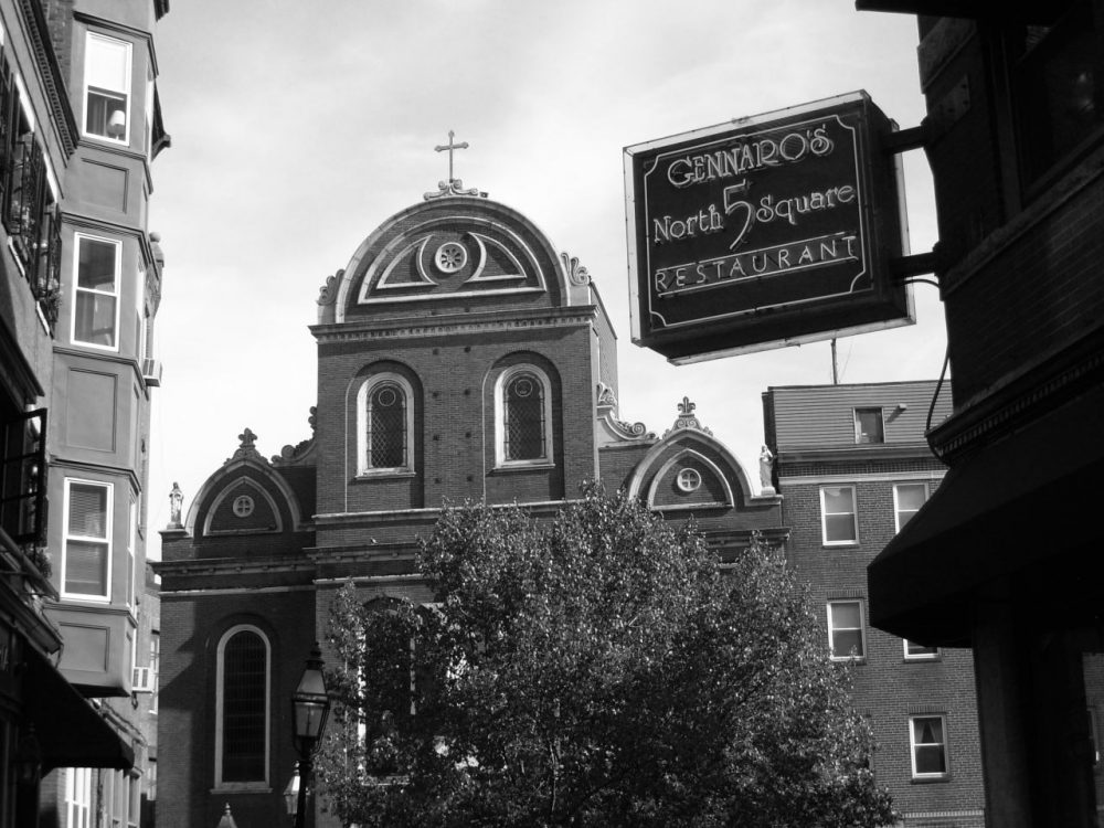 """Erika Fine: """"The sign reminds me that, even in America, even in a dynamic, progressive city like the new Boston, Jews might still, to some extent, be considered 'other.'"""" Pictured: The Sacred Heart Church seen from Prince Street in Boston's North End. (Aidan Wakely-Mulroney/flickr)"""