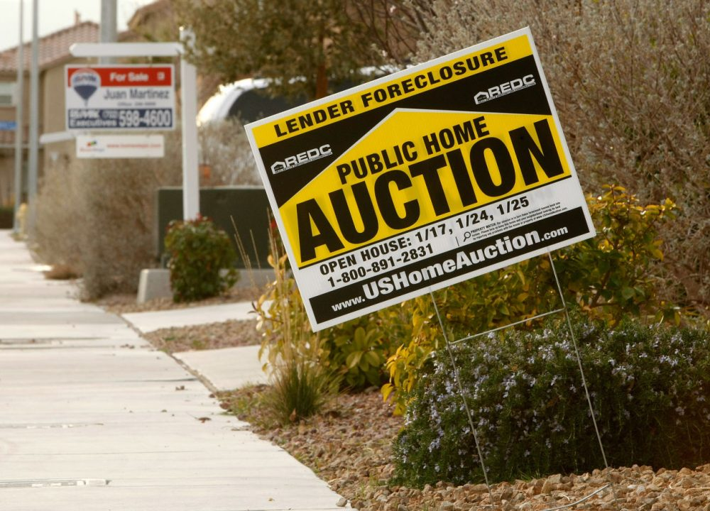 Signs are seen outside a foreclosed home and a house for sale February 24, 2009 in North Las Vegas, Nevada. (Ethan Miller/Getty Images)