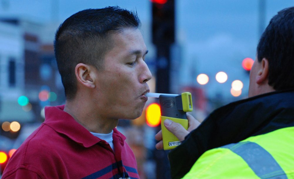 A breathalyzer test is administered. The tests were barred from evidence in most Massachusetts drunken driving cases after it was discovered that the state wasn't transparent about flaws in testing. (KOMUnews/Flickr)