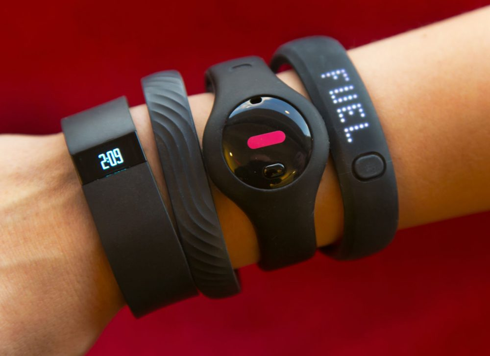 John Hancock Financial is the first U.S. insurer to offer discounts to policyholders who wear Internet-connected fitness trackers, like the ones pictured here. (Richard Drew/AP)
