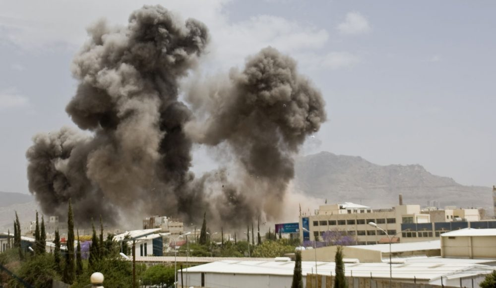 Smoke billows from a Saudi-led airstrike on Sanaa, Yemen, Wednesday, April 8, 2015. A state-run broadcaster in Iran is reporting that the Islamic Republic has sent a navy destroyer and another vessel to waters near Yemen amid a Saudi-led airstrike campaign. (Hani Mohammed/AP)