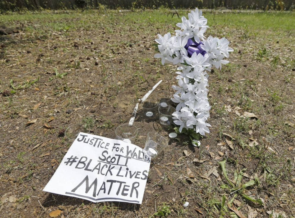 A memorial is placed near the site where Walter Scott was killed in North Charleston, S.C., Wednesday, April 8, 2015. Scott was killed by a North Charleston police officer after a traffic stop on Saturday. The officer, Michael Thomas Slager, has been charged with murder. (AP)