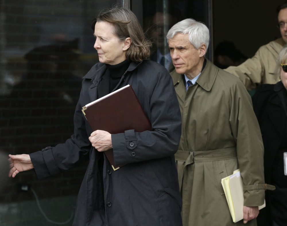 Defense attorneys Judy Clarke, left, and David Bruck leave federal court Wednesday following the verdict.  (Steven Senne/AP)