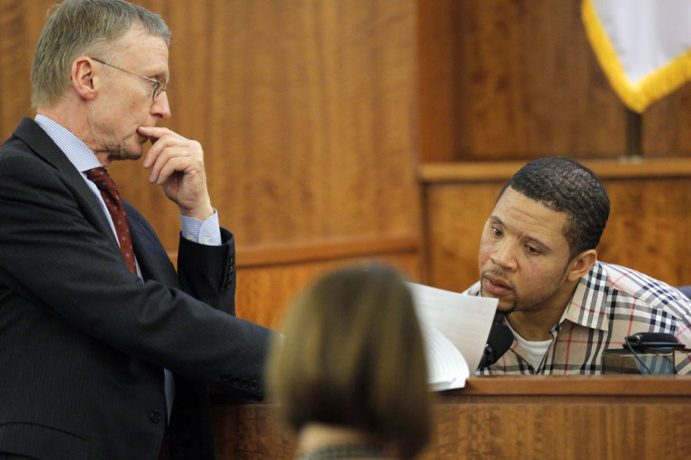 Defense attorney Charles Rankin, left, cross examines prosecution witness Alexander Bradley during former Aaron Hernandez's murder trial Wednesday. (Brian Snyder/AP/Pool)