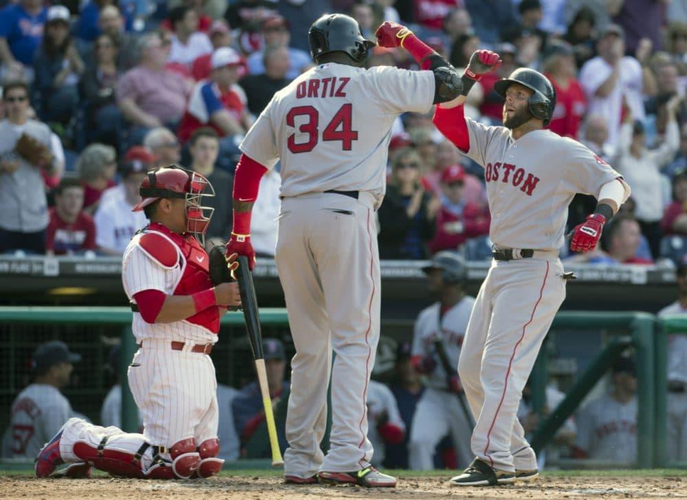 Dustin Pedroia celebrates his home run with David Ortiz during the season opener against the Phillies Monday in Philadelphia. (Chris Szagola/AP)