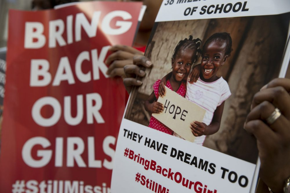 """Protesters holds up placards demanding help from the Nigerian government to find the 219 girls who remain missing on the first anniversary of the kidnapping by Islamic extremists, during a demonstration Tuesday outside the Nigerian High Commission in London. April 14 marked one year since the abduction from their school in Chibok, Nigeria, but Nigeria President-elect Muhammadu Buhari said Tuesday that """"We do not know if the Chibok girls can be rescued. Their whereabouts remain unknown."""" (Alastair Grant/AP)"""
