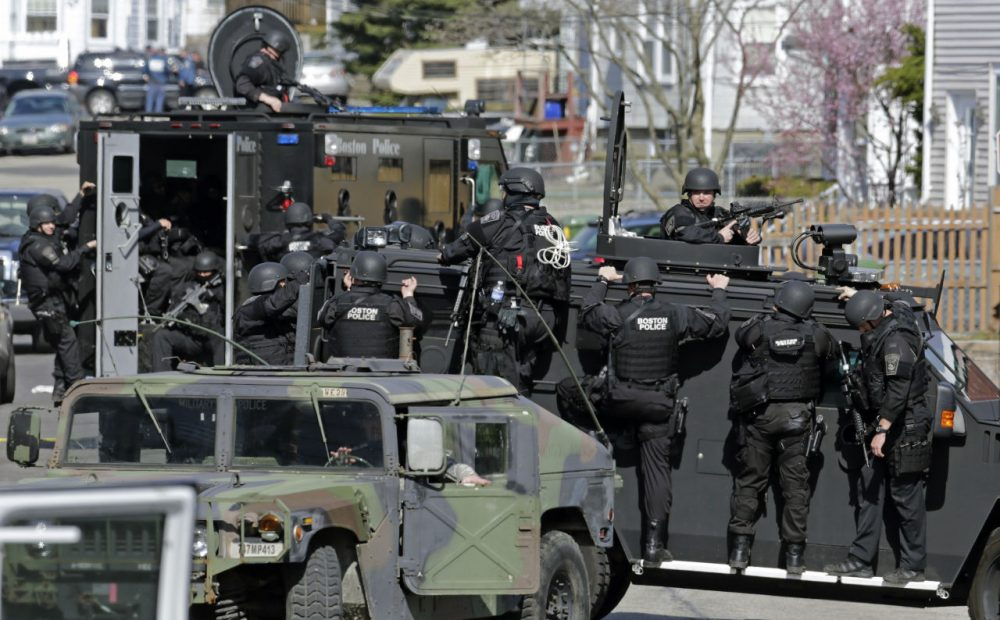 Tactical teams drive through Watertown while searching for Dzhokhar Tsarnaev following the Boston Marathon bombings. (AP)