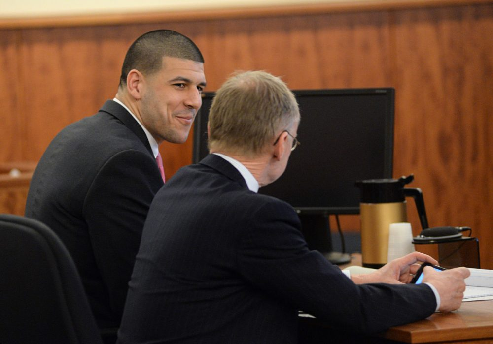 Aaron Hernandez talks with his defense attorney Wednesday. (Faith Ninivaggi/AP/Pool)