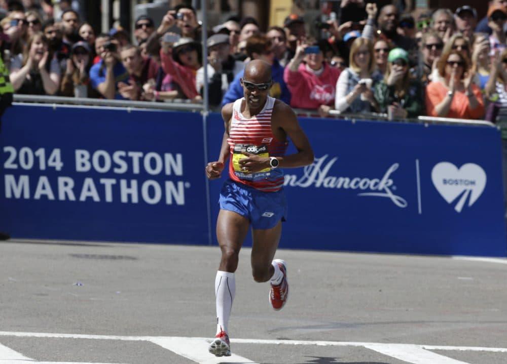 Meb Keflezighi turns onto the last stretch before winning the 118th Boston Marathon, Monday, April 21, 2014. (AP Photo/Steven Senne)
