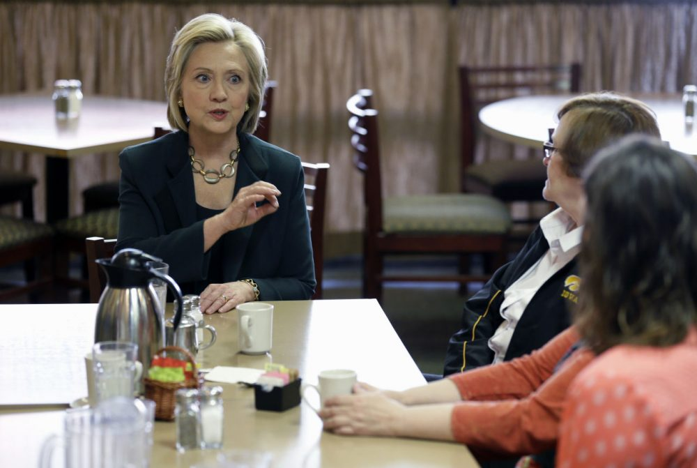 Democratic presidential candidate Hillary Rodham Clinton, left, visits with local residents at The Tremont, Wednesday in Marshalltown, Iowa. (Charlie Neibergall/AP)