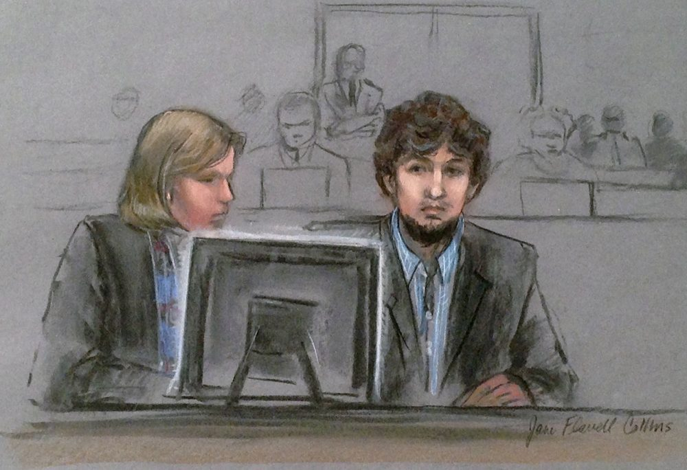 In this courtroom sketch, Dzhokhar Tsarnaev, right, and defense attorney Judy Clarke are depicted watching evidence displayed on a monitor during his federal death penalty trial Monday, March 9, 2015, in Boston. Tsarnaev is charged with conspiring with his brother to place two bombs near the marathon finish line in April 2013, killing three and injuring 260 spectators. (AP)