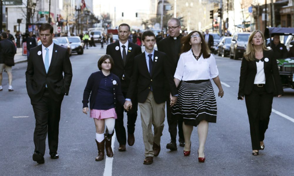 The family of Martin Richard, the youngest bombing victim, walks down Boylston Street with Boston Mayor Marty Walsh after a ceremony on Boylston Street Wednesday morning. (Charles Krupa/AP)