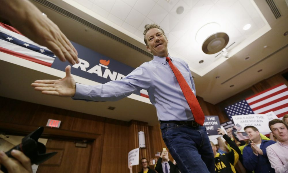 Republican presidential candidate Sen. Rand Paul, of Kentucky, greets a supporter during a rally in Iowa Friday. (Charlie Neibergall/AP)