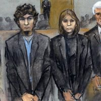 In this courtroom sketch, Dzhokhar Tsarnaev, second from left, is depicted standing with his defense attorneys William Fick, left, Judy Clarke, second from right, and David Bruck, right, as the jury presents its verdict in his federal death penalty trial Wednesday, April 8, 2015, in Boston. Tsarnaev was convicted on multiple charges in the 2013 Boston Marathon bombing. Three people were killed and more than 260 were injured when twin pressure-cooker bombs exploded near the finish line. (Jane Flavell Collins/AP)