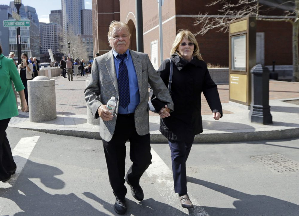 "Robert Fitzpatrick walks from federal court in Boston Thursday, accompanied by his wife, Jane. Federal officials are accusing Fitzpatrick, a former FBI agent, of lying to jurors during mobster James ""Whitey"" Bulger's trial. (Elise Amendola/AP)"