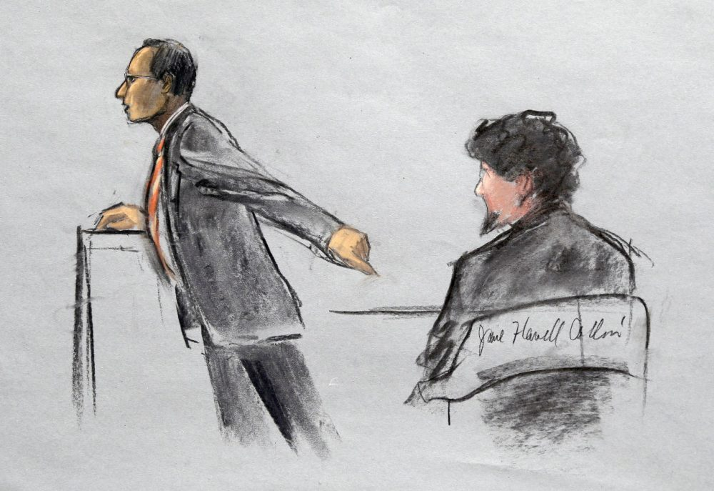 In this courtroom sketch, Assistant U.S. Attorney Aloke Chakravarty points to defendant Dzhokhar Tsarnaev, right, during closing arguments in Tsarnaev's federal death penalty trial Monday. (Jane Flavell Collins/AP)