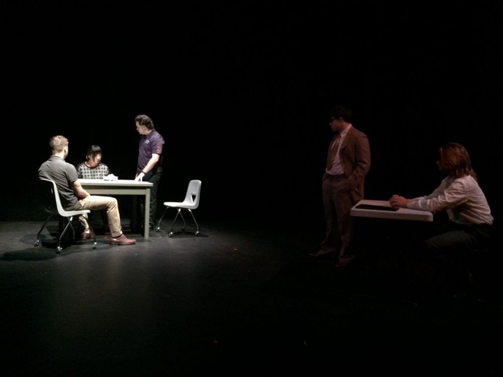 LEFT - Worcester Police Sergeant Kevin Pageau (portrayed by Ben Gold '13) and Detective John Doherty (portrayed by Ryan Mouton '17) interrogate Nga Truong (portrayed by Christine Kim '17) about the alleged murder of her son. RIGHT - Attorney Ed Ryan (portrayed by Dylan Hoffman '18 ) and WBUR journalist David Boeri (portrayed by Sumner Alperin-Lea '18) watch this flashback of the interrogation. (Courtesy  Julian Seltzer)