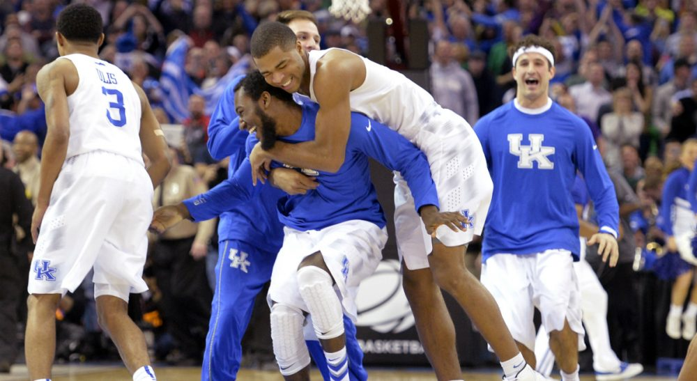 Kentucky players celebrate after a 68-66 win over Notre Dame in a college basketball game in the NCAA men's tournament regional finals, Saturday, March 28, 2015, in Cleveland. (David Richard/AP)