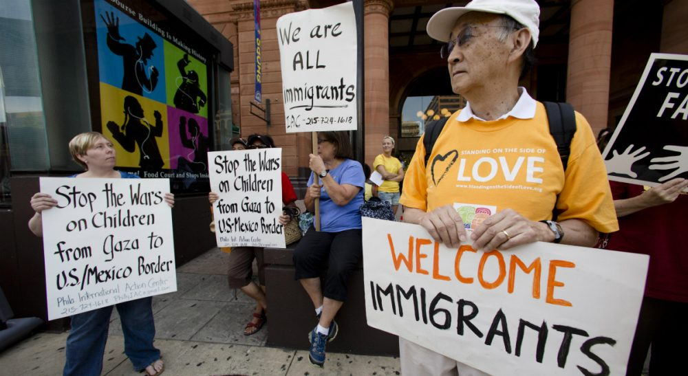 "John Tirman: ""We should begin to understand who our immigrant population is -- where they came from and why, their aspirations, their contributions to American society -- in order to help this new (and great) migration succeed for all."" Pictured: July 18, 2014, protestors in Philadelphia demonstrate near the Consulate of Mexico in support of immigrants entering the United States via Mexico. (Matt Rourke/AP)"
