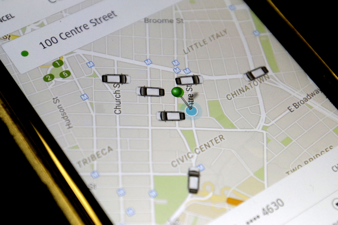The Uber app displays cars available to make a pickup in downtown Manhattan on a smart phone. (Mary Altaffer/AP)