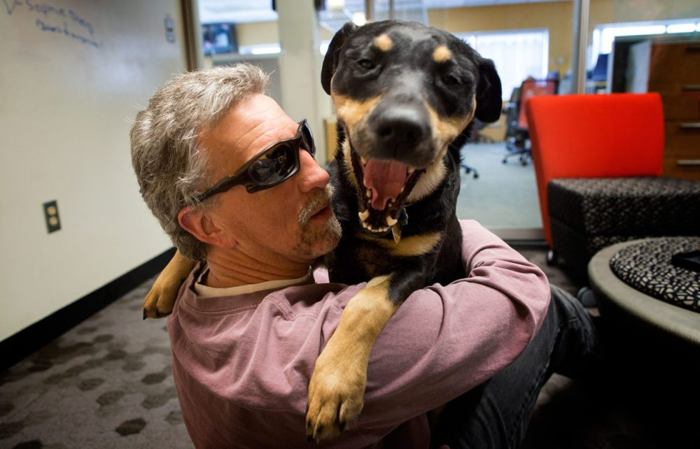 Randy Pierce with his guide dog, Autumn (Photo: Robin Lubbock/WBUR)