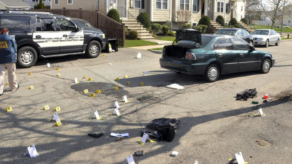 This undated forensics photograph released March 24 by the U.S. Attorney's office and presented as evidence during the federal death penalty trial of Dzhokhar Tsarnaev, shows the scene of the April 19, 2013, gun battle in Watertown, Mass., between police and Dzhokhar and Tamerlan Tsarnaev. (U.S. Attorney's Office/AP)