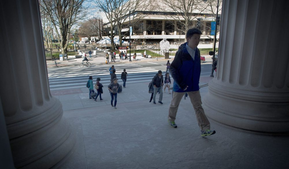 Student climb the steps of the Rogers building at MIT. (Robin Lubbock/WBUR)