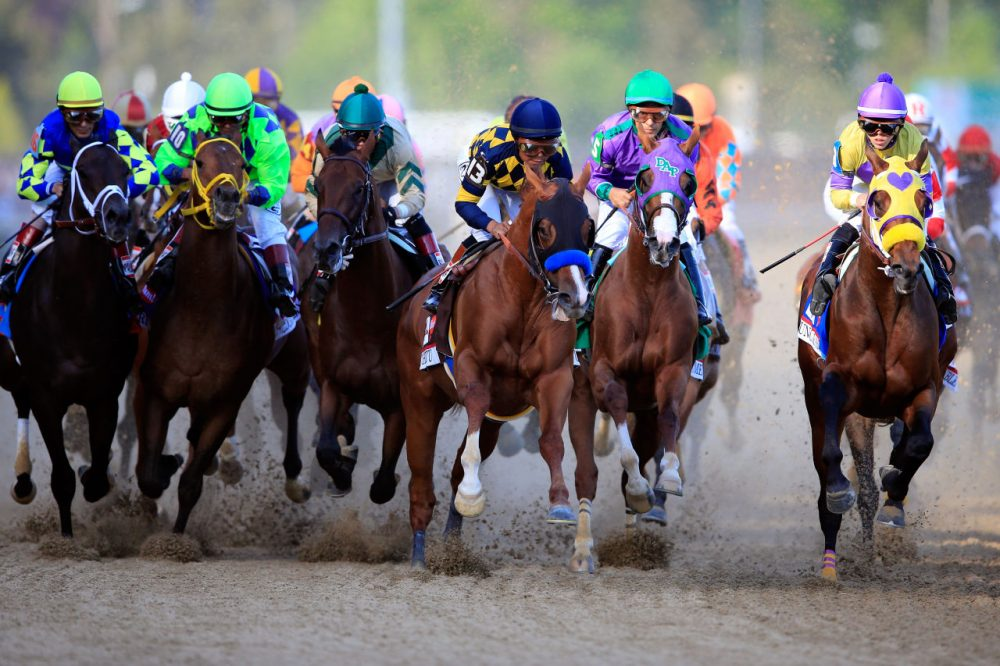 Jockey Victor Espinoza guides California Chrome #5 to the finish line to win the 140th running of the Kentucky Derby at Churchill Downs on May 3, 2014 in Louisville, Kentucky. (Rob Carr/Getty Images)