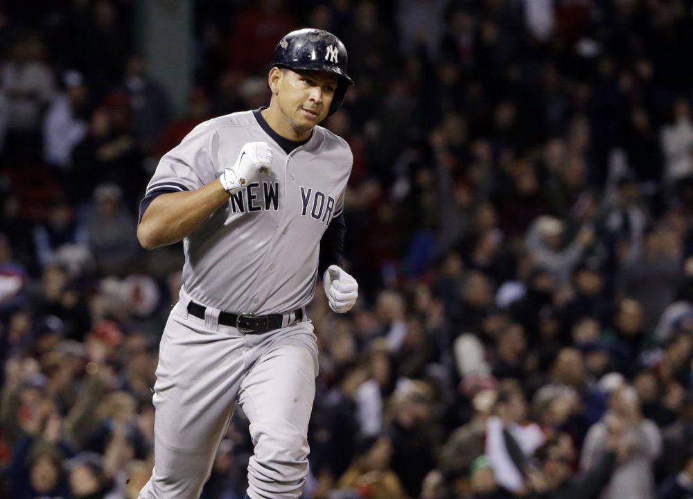 Alex Rodriguez runs to first after hitting a solo homer.  Rodriguez has now tied slugger Willie Mays with 660 career home runs. (AP Photo/Elise Amendola)