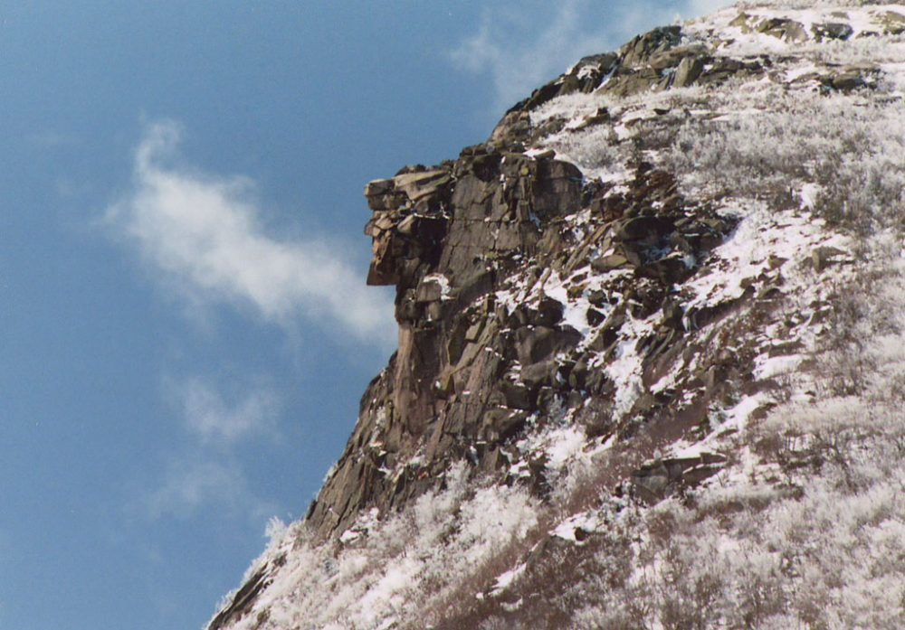 Old Man of the Mountain on April 26, 2003, seven days before the collapse. A late spring snow fell the night before. (Wikimedia Commons)