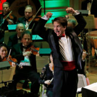 """Boston Pops Conductor Keith Lockhart leads the 31st annual """"A Company Christmas at Pops"""" at Symphony Hall in Boston in 2014. (Elise Amendola/AP)"""