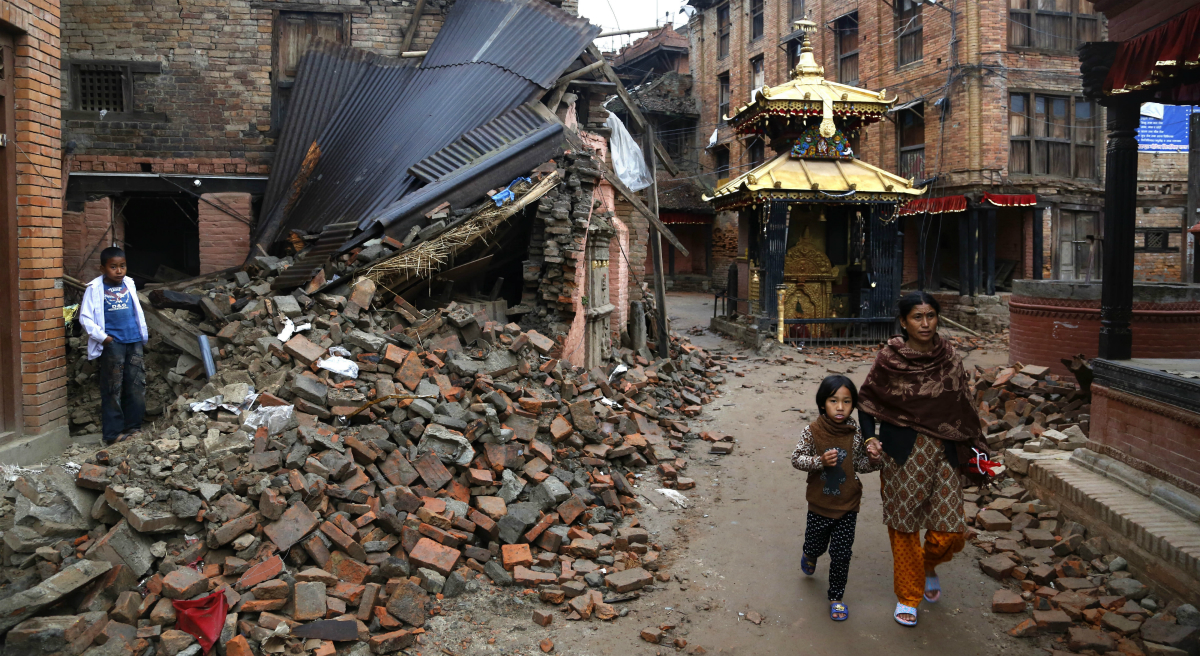 What lies beneath the rubble in Kathmandu? Memories and monuments. The first can be reconstructed, says Jessica Lipnack, the second, largely, cannot. In this Thursday, April 30, 2015 photo, a Nepalese woman and a child walk near rubble of a collapsed building in Kathmandu, Nepal. (Manish Swarup/AP)