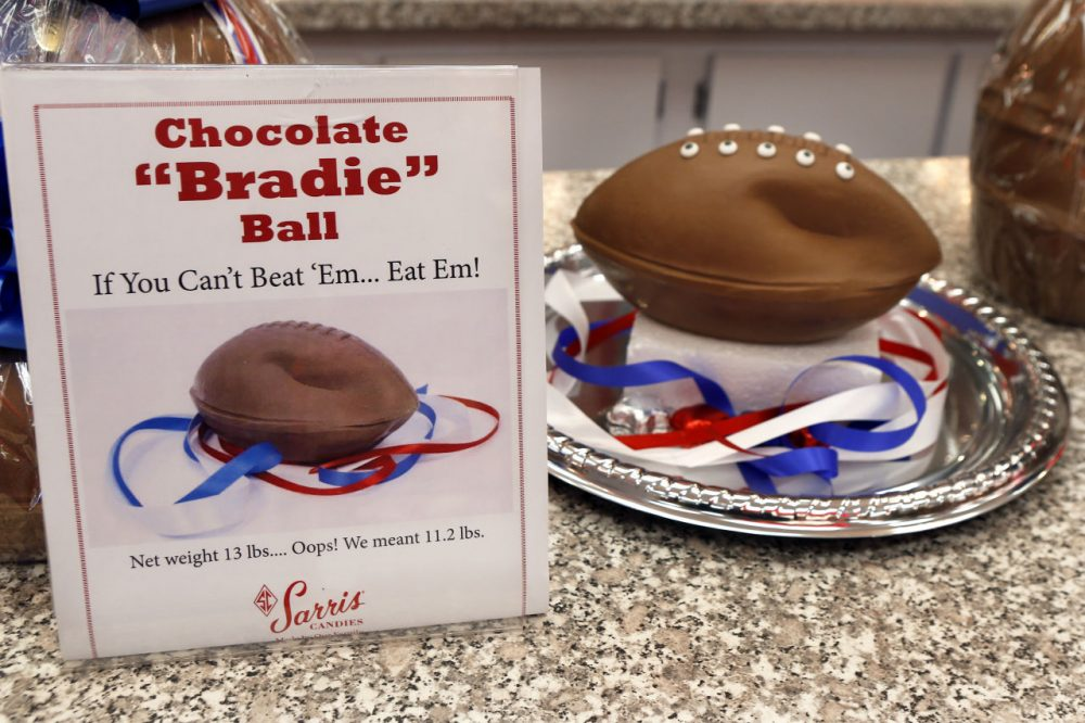 "A ""deflated"" chocolate football called a ""Bradie"" Ball is on display at Sarris Candy store in in Canonsburg, Pa.  (Keith Srakocic/AP)"