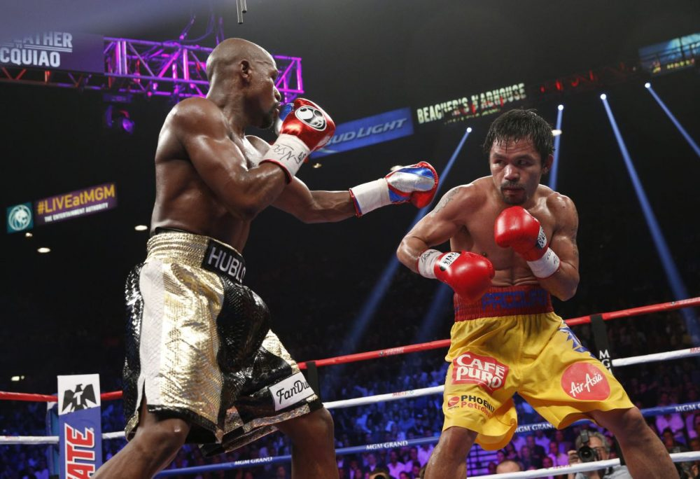 """Saturday's bout between Floyd Mayweather (lefty) and Manny Pacquiao (right) was labeled the """"fight of the century."""" It was not. (John Gurzinski/AFP/Getty Images)"""