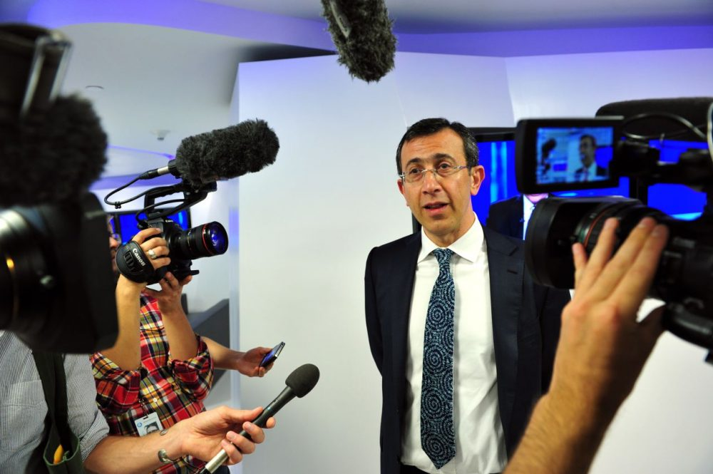 Al Jazeera America CEO Ehab Al Shihabi speaks to journalists in the lobby of the new Al Jazeera America television broadcast studio on West 34th Street August 16, 2013 in New York, ahead of the launch on August 20. (Stan Honda/AFP/Getty Images)