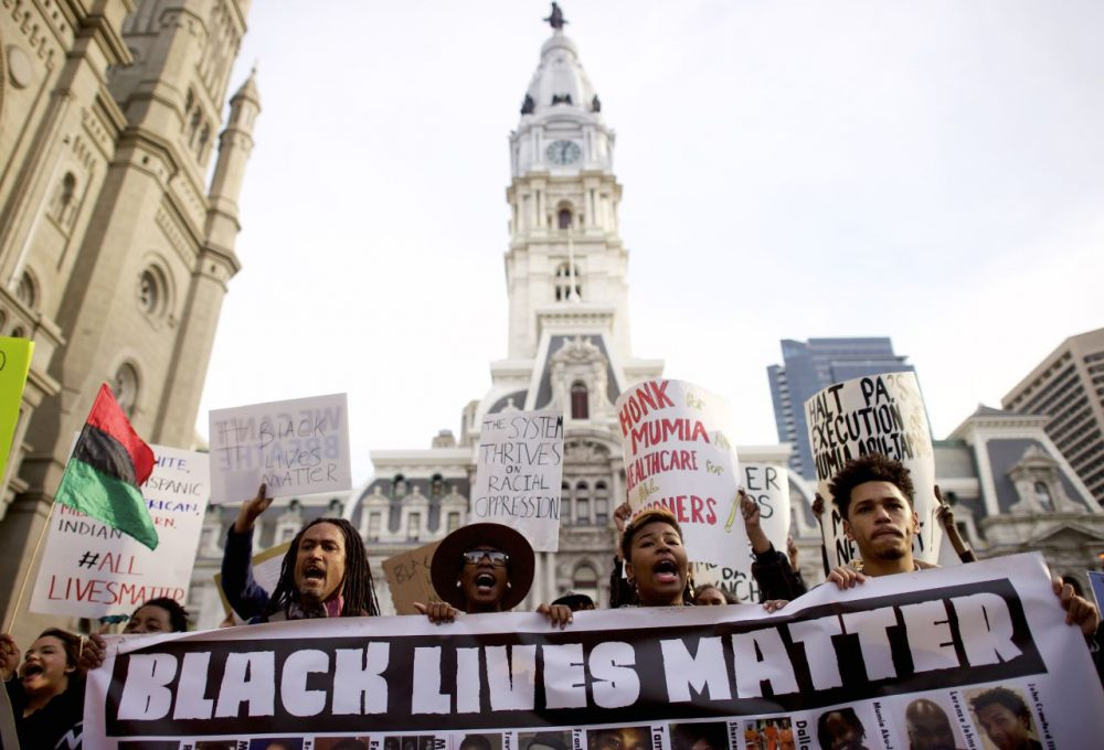 Protesters march past City Hall during a demonstration over the death of Freddy Gray outside City Hall on April 30, 2015 in Philadelphia, Pennsylvania. Freddie Gray, 25, was arrested for possessing a switch blade knife April 12 outside the Gilmor Houses housing project on Baltimore's west side. According to his attorney, Gray died a week later in the hospital from a severe spinal cord injury he received while in police custody. (Mark Makela/Getty Images)