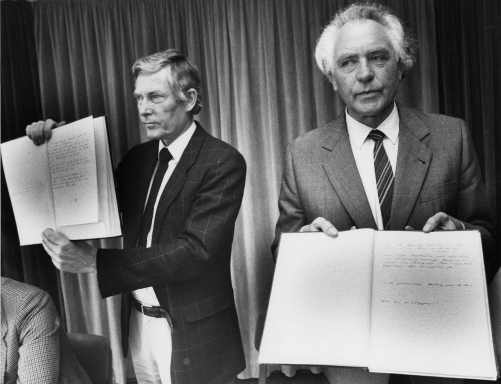 Hans Booms, right, president of the West German Federal Archives and Dr. Louis Ferdinand Werner member of the Federal Criminal Office hold copies of the faked Hitler diaries at a press conference in Koblenz, West Germany, Friday May 6, 1983. (Kurt Strumpf/AP)