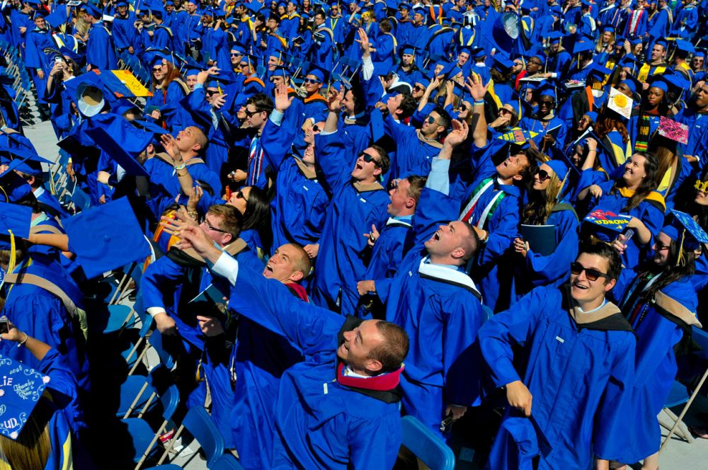 In this May 31, 2014 file photo, graduates throw their caps in the air in triumph at the University of Delaware's commencement ceremony in Newark, Del.  It turns out their majors might matter more than they think in their future earnings. (Emily Varisco/AP)