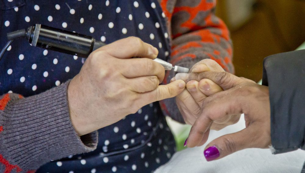 A customer receives a manicure at a nail salon in New York in January. (Bebeto Matthews/AP)