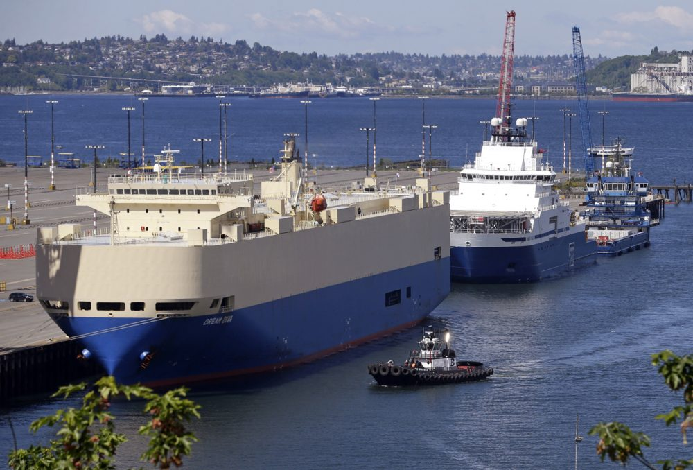 On May 6, 2015, two ships sit moored at Seattle's Terminal 5, including the Shell support vessel Aiviq, where Royal Dutch Shell wants to park two massive Arctic oil drilling rigs. (Elaine Thompson/AP)