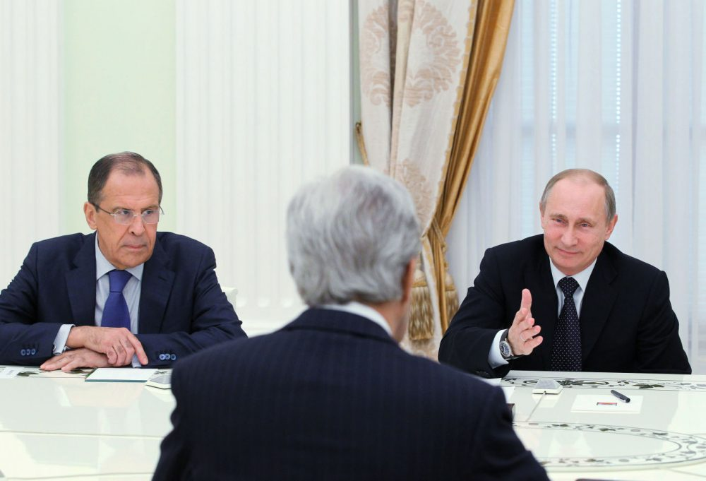 Russia's President Vladimir Putin (right) and Foreign Minister Sergei Lavrov (left) hold talks with U.S. Secretary of State John Kerry (center) in the Kremlin in Moscow, on May 7, 2013. Kerry sought to narrow differences over the conflict in Syria with Putin, urging the Russian strongman to find common ground to help end the bloodshed. (Mikhail Klimentyev/AFP/Getty Images)
