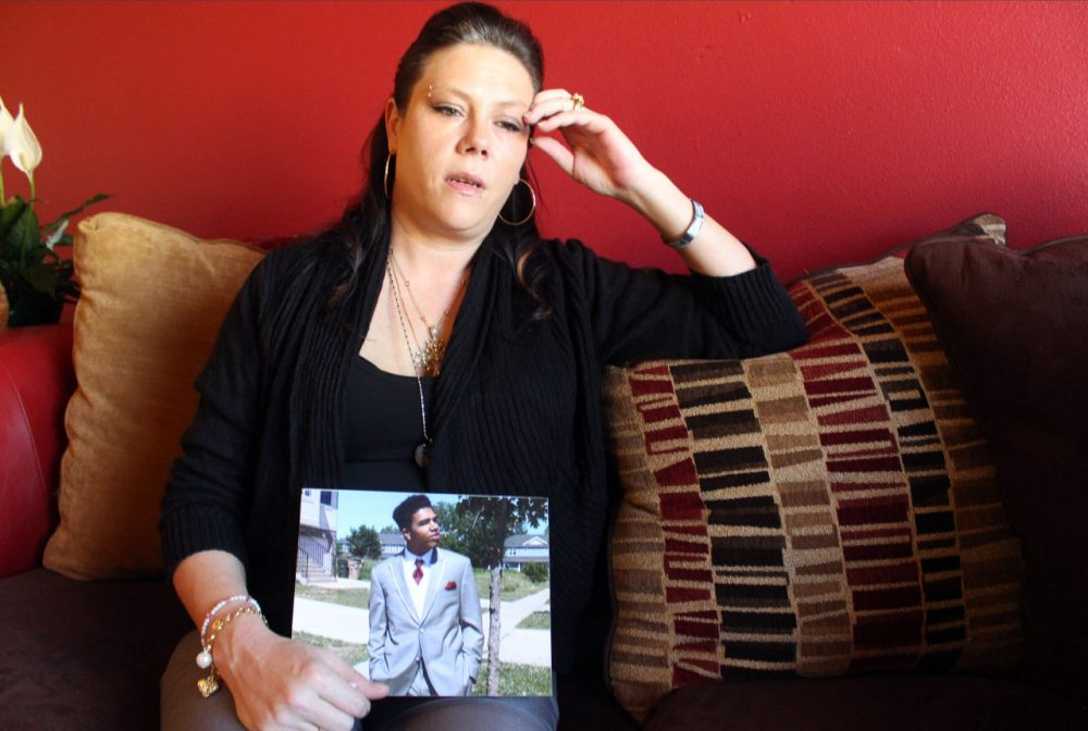 Andrea Irwin holds a photo of her son Tony Robinson, on April 1, 2015 in Madison, Wis. Irwin, whose biracial son died at the hands of a white Madison Wisconsin police officer in March, says she trusts prosecutors will get to the truth of what really happened. (Carrie Antlfinger/AP)