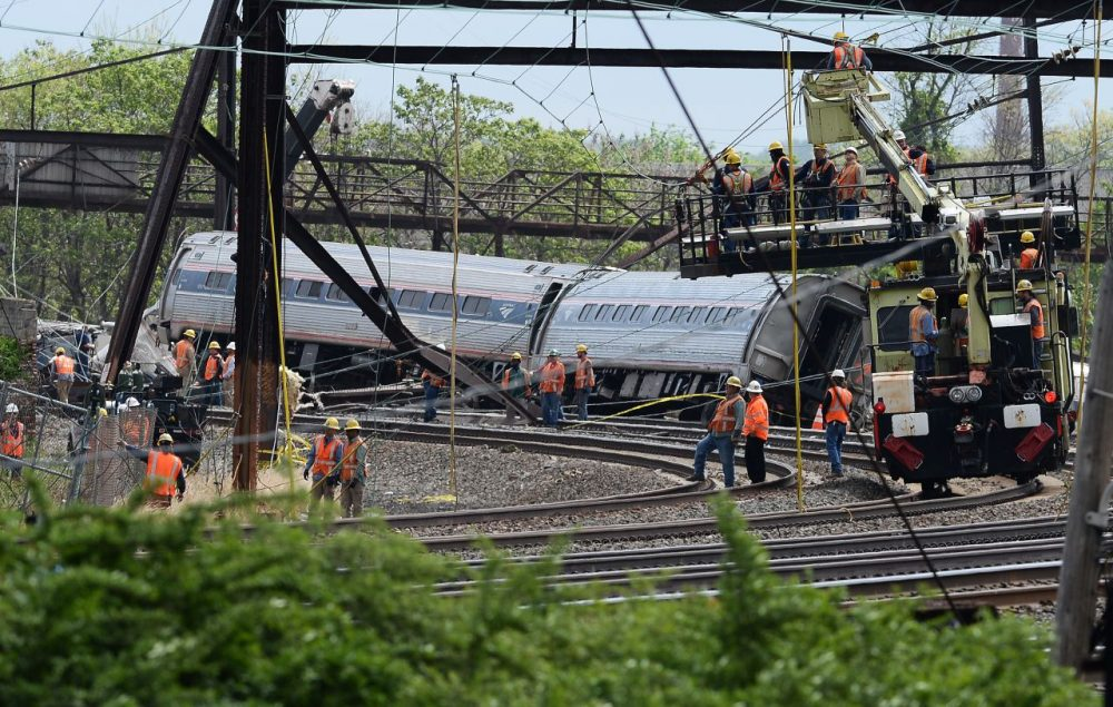 Rescuers work around derailed carriages of an Amtrak train in Philadelphia, Pennsylvania, on May 13, 2015. Rescuers on May 13 combed through the mangled wreckage of a derailed train in Philadelphia after an accident that left at least six dead, as the difficult search for possible survivors continued. (Jewel Samad/AFP/Getty Images)
