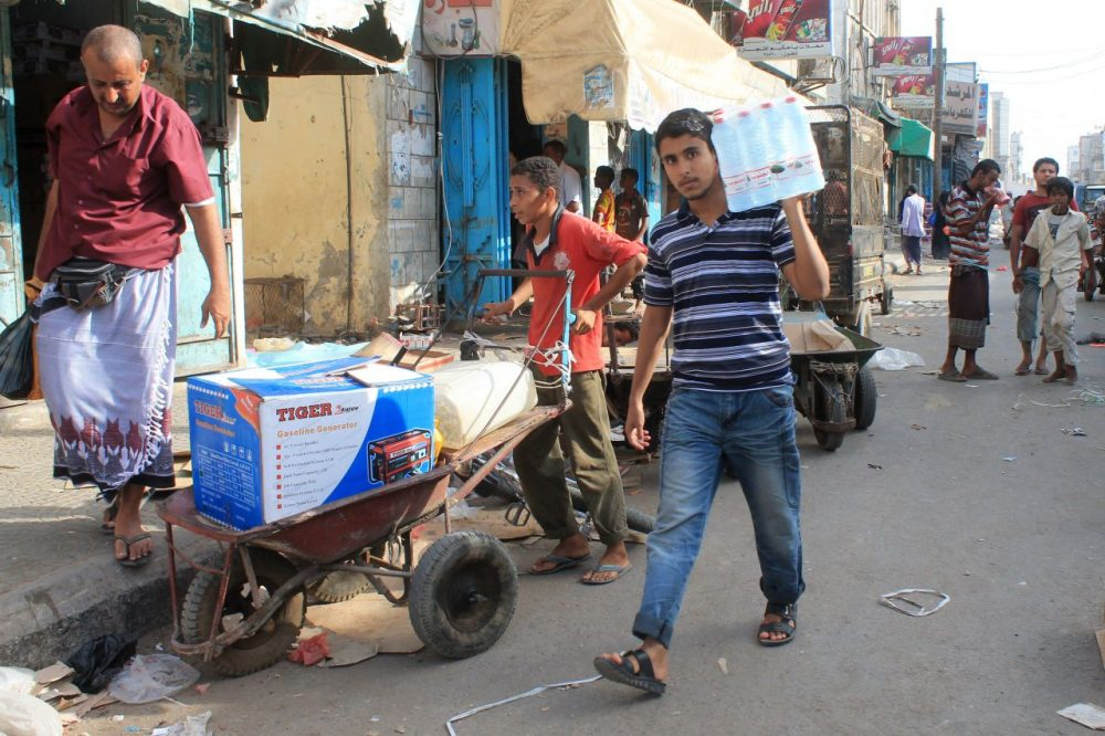 Yemenis purchase goods in the Sheikh Othman area, in the southern Yemeni port city of Aden, on May 13, 2015. King Salman doubled Saudi Arabia's Yemen aid commitment to $540 million, the first day of a humanitarian pause in a bombing campaign it has led against neighboring rebels. (Saleh Al-Obeidi/AFP/Getty Images)