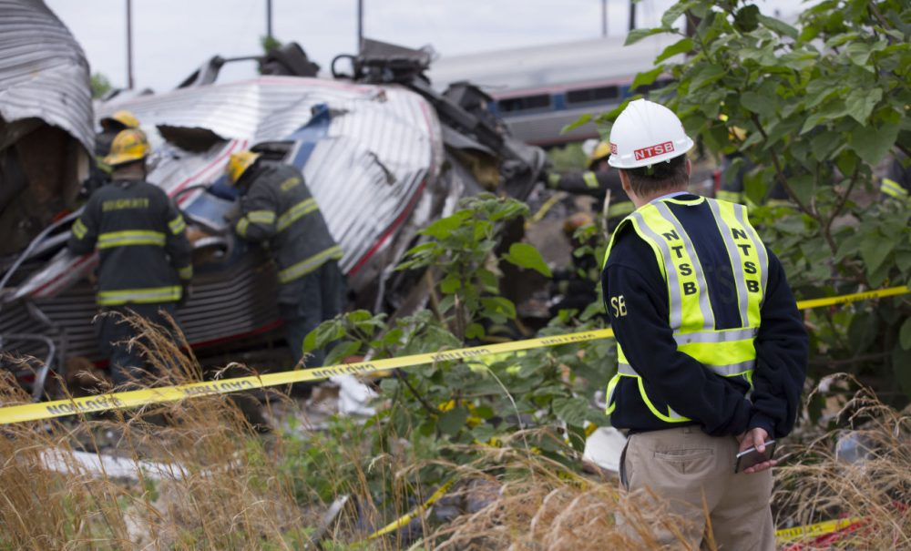 NTSB member Robert Sumwalt works on the scene of the Amtrak Train #188 derailment on May 13, 2015 in Philadelphia, Pennsylvania. (NTSB via Getty Images)